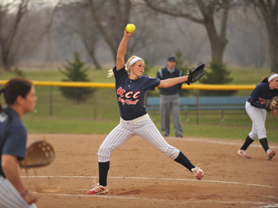 Photo of Erin Gaston pitching at a game on the KCC Softball Field